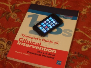 A clinical treatment planning book with an iPod Touch on top